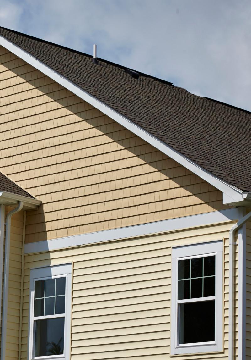 Tan house with shingle roof and siding